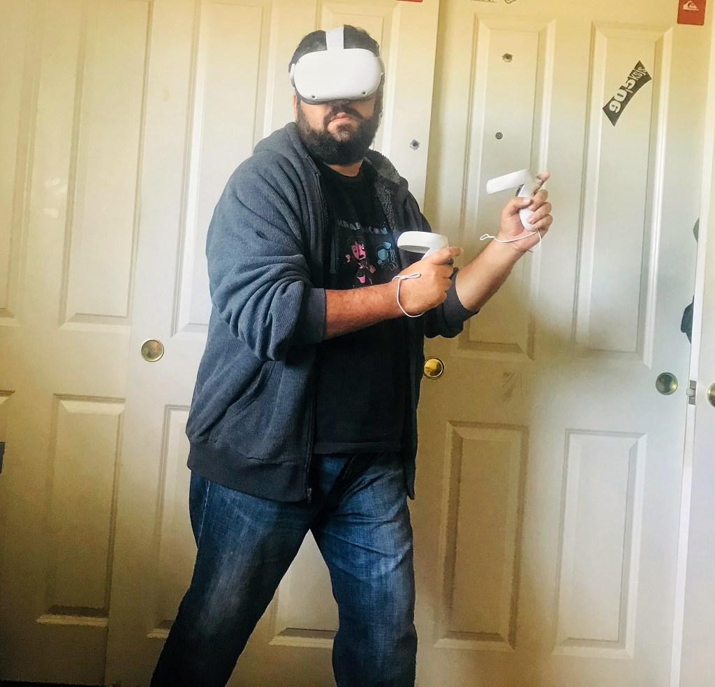 Stan Rezaee playing the Oculus Quest 2. 8Bit/Digi
